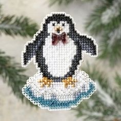 "MH189301 - Proud Penguin (2009) - Mill Hill - Seasonal Ornament / Pin Kits - Winter Holiday Kit Includes: Beads, treasures, perforated paper, floss, specialty threads, needles, chart, magnet and instructions. (1 of 6 designs in display  **Glue Velcro (NOT included) to back for additional uses. Size: 2.5"" x 3"""