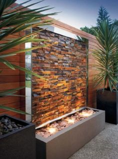Ambient lighting against wall cladding, what an outcome! Our #kakadu rockface stack stone is a constant favourite among our clients and I'm sure you can see why. #cladding #panels