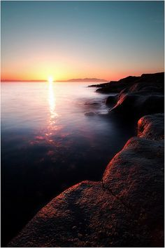 A beautiful sunset over the Isle of Arran, shot from the rocks at the Ballast Bank in Troon, Scotland. http://flic.kr/p/bGgktr