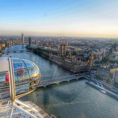 London classic ferris wheel: hire photographer to take shots of proposal occurring in the carriage in front or ahead with same background or backdrop of city.