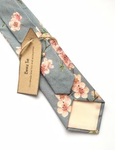 Men's floral tie in grey and blush cherry blossom print linen. Mens Wedding Ties, Wedding Attire, Wedding Dress, Cherry Blossom Wedding, Browns Gifts, Tie And Pocket Square, Pocket Squares, Dog Bows, Skinny Ties