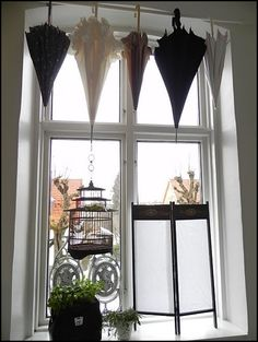 umbrella window treatment...I love quirky ideas like this! :)