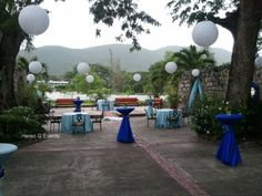 Cocktail reception decor by Helen G Events. Various shades of blue with Chinese lanterns. #jamaica #cocktailreception #bluedecor #chineselanterns