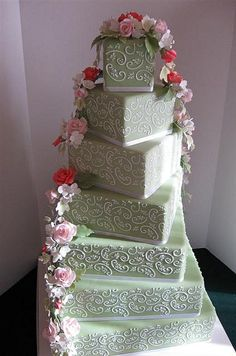Square Stenciled Wedding Cake by Elegant Cake Creations AZ, via Flickr  Not a fan of the stencil on the cake, but I like the design of the cake