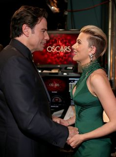 Pin for Later: Oscars 2015: You Definitely Didn't See These Moments on TV John Travolta and Scarlett Johansson