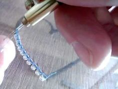 demo - in french - attaching beads - tambour