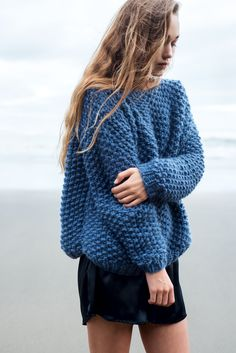 Oversized, long-sleeved boatneck sweater with ribbed cuffs and hem. Hand knitted in a beautiful chunky, moss-stitch, the Lulu Sweater is definitely one of our favourites. Hand knitted with love, we bet you won't want to take yours off. 100% wool moss-stitch chest width 58cm, body length 52cm, sleeve