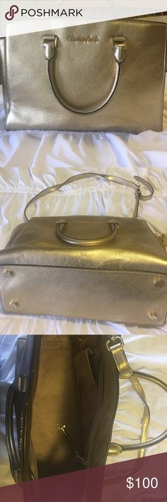 Gold Michael Kors Purse Lightly used. Great medium sized bag with several pockets! Has a removable strap. Willing to negotiate price! Michael Kors Bags Shoulder Bags