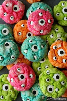Gooey Monster Cookies!! { lilluna.com } Beat 1/2 cup softened butter, 1/2 tsp vanilla, 1 egg and 8 oz. cream cheese until fluffy. Mix in a box of yellow cake mix. Add green food coloring until it's the color you want. Chill for 30 minutes.  Roll into balls and dip in a bowl of powdered sugar. Bake at 350 for 10-12 minutes. While warm push eye balls into the center or all over the cookie. ENJOY!