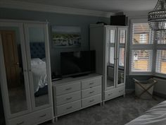 Master bedroom in my Victorian house renovation. Bay windows. Plaster coving. Wood shutters. Plaster ceiling rose. Mixing in Ikea furniture. Tyssedal range