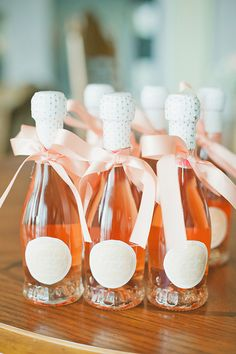 Wedding morning champagne with peach ribbon for maids. Event Planner: Frank Martinez.
