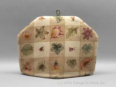 Tea Cozy - Pastoral Plaid|Standard . $27.95. Cream and sand background for a multicolored botanica design. Very popular!