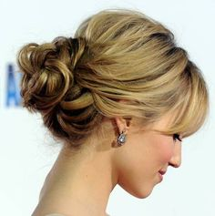 "#1 Messy Buns - Whether its in the middle or on the side, up high or down low, the ""messy"" bun is all the rage in hollywood. It looks effortless and simple with a little kick of that ""slept in"" quality."