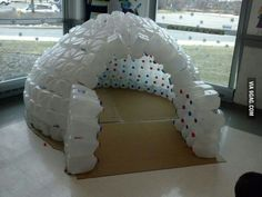 Kids fort from milk jugs. We could do this for outside in the winter. It would soak up the heat and be an area for them to play.