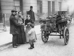 Credit: Topical Press Agency/Getty Images A street hawker takes advantage of the coal porters' strike by selling wood blocks to domestic users