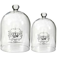 "Glass Cloche Bell Jar 15""/12"" w/ Crown Set Of 2 by FantasticDecor. $57.99. Buy multiple items, save on shipping. With impressive size and shape, this set of two unique and gorgeous Glass Cloche is both decorative and functional. They will protect an early garden plant from bleak cold and frost and make a wonderful garden accent, or use as a food cover for your next gathering. Measures L: D9.5""x15"", S: D8.5""x12"". Set of two."