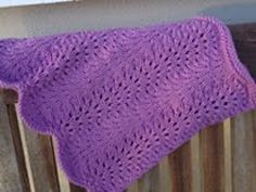 The Clara Cowl by Caroline Lehane.  Free pattern in the Feather and Fan stitch.