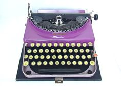 purple typewriter *RARE* vintage typewriter remington portable gifts for writers wedding decor boho decor wedding guest book film prop by thespectaclednewt on Etsy https://www.etsy.com/listing/190793535/purple-typewriter-rare-vintage