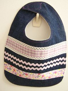 Denim bib with purple and pink ribbons and trims by EverSewSweet