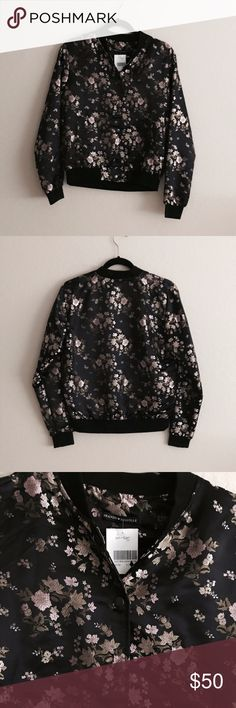 """[Brandy Melville] Silk Floral Bomber Jacket **REPOSH** I bought this beautiful NWT Brandy Melville jacket but unfortunately it isn't the thickness I was looking for.  No flaws, never worn.   Silky and satin Bomber with cherry blossom embroidery, snap buttons on front with side pockets.  100% cotton.  23"""" Lenth, 20"""" Bust.  One Size.   This is a light to medium thickness jacket.  More than just a shell.  Good for fall! Brandy Melville Jackets & Coats"""