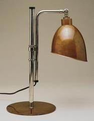 "Table Lamp, designed by Christian Dell (1928)  ""German Bauhaus objects are characterized by their simple forms, clean lines, and inexpensive materials. A superb example of pure Bauhaus design, this adjustable table lamp is the only work by Christian Dell in an American collection. Dell held the position of Master Craftsman at the Dessau metal workshop, and the shape of the modern office light was largely developed by him. This work's austere geometrical form and mechanized appearance remain…"