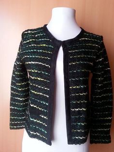Check out this item in my Etsy shop https://www.etsy.com/listing/219448418/vintage-black-cardigan-knitwear-top-v