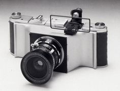 The 'Longfellow' is a medium format panoramic camera that utilizes fused bodies of two 6x9 folders. The Super angulon 90 was mounted on a c...