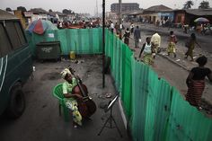 Joesphine Mpongo, 37, practices the cello in the Kimbanguiste neighbourhood of Kinshasa, DR Congo. The Kimbanguiste Symphony Orchestra practise here 5 days per week.