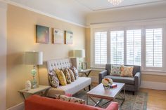 This living room is brought to life by the colorful accents seen in the pillows, artwork, and rug.
