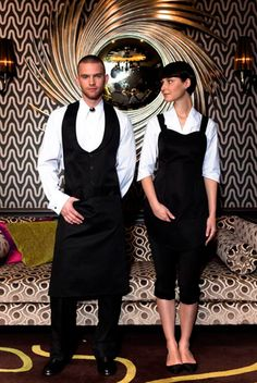 What the wait staff's uniforms will look like with the addition of red bow ties for both male and female.