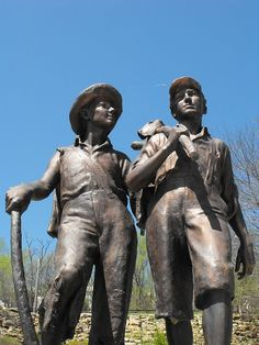 Statue of literary characters, Tom Sawyer and Huck Finn at the base of Cardiff Hill in Hannibal, Missouri.