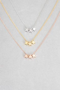 Brushed three star charm necklace.