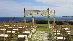 Scenic backdrop for a wedding with panoramic views of the Kapalua cliffside and Honolua Bay. Ritz Carlton Kapalua Maui