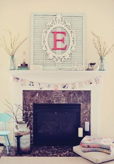 Cute! Too bad we have a Tv over our fireplace.. :(  Def doing the framed letter as wall art somewhere though!