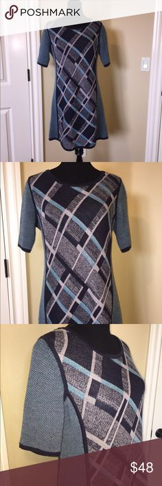 """Anthropologie Sparrow Wool Dress Gorgeous Anthropologie Sparrow wool blend short sleeve dress. Pattern in navy blue, turquoise and gray on front and back. Navy blue trim. Elbow length sleeves. 34"""" length. 50% Wool/50% acrylic. Size L. Anthropologie Dresses"""