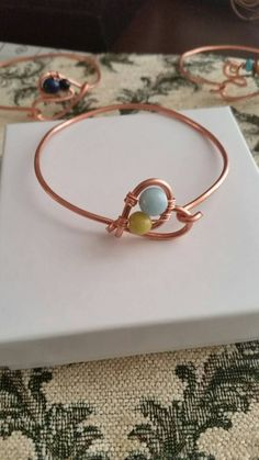 Check out this item in my Etsy shop https://www.etsy.com/listing/497217490/copper-heart-and-gemstone-bangle