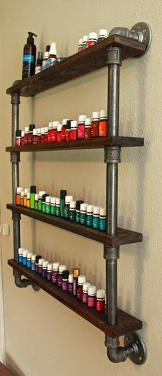 A Young Wife's Tale: DIY Essential Oil Shelf Diy Nail Polish Rack, Nail Polish Shelves, Essential Oil Shelf, Essential Oil Holder, Essential Oils, Black Pipe Shelving, Copper Pipe Shelves, Iron Pipe Shelves, Industrial Pipe