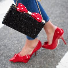 oh minnie, oh my! @atlanticpacific pairs her kate spade new york for minnie mouse clutch with a sleek black shirt and jeans. #minniestyle