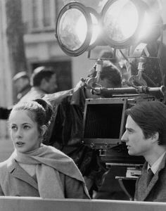 """Baisé volé"" (""Stolen Kisses"") directed by François Truffaut. Believe that is Truffaut looking through the camera's viewfinder at the set-up."