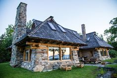 Tour this stunning Littleton NH home featuring handcrafted stone and log designs, along with the property's caretaker cottage.