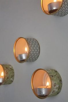 Recycled Tin Wall Lamps     ~ I think that if these were painted with weather resistant paint & mounted on a board, it would make an excellent outdoor/patio accent.