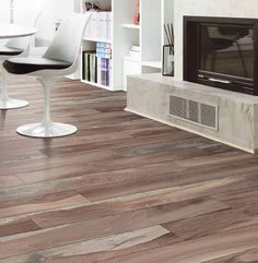 Our Martis porcelain wood like tile series is a beautiful mix of rustic and modern. With the convenience of tile and the beautiful look of wood it's a great series for any project! Shown here in the Brown color #tile #tiles #tileaddiction #tilework #wood #woodfloor #woodtile #tilefloor #floortiles #floortile #hardwood #hardwoodfloors #interior #interiors #interiordecor #interiorstyling #interiordesign #design #living #livingroom #livingroomdecor #architecture #yesthisisreallytile…