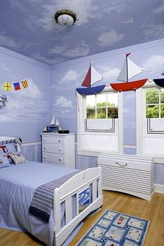 CHILDRENS BEDROOMS; Little boys room with sailing theme,sailboat valance trim,sailors collar for curtains,painted murals of clouds,Oak Park Infant Welfare showhouse 2007 - Royalty Free Images, Photos and Stock Photography :: Inmagine