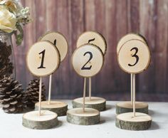 This Listing is for - Stand Alone Log Slice Table Numbers: Set of (17) with the option of adding additional Numbers on the drop down menu. Numbers are Hand Stenciled and Painted on ONE side. The other side is left blank. Option to purchase double sided numbers on the drop down menu Approx Measurements:  - 2-4 Diameter Top log slice (numbered)  - Base Log is 3-4 Diameter (BASE log will be approx the same size or 1/2-1 larger in diameter to hold the top without tipping)  - Slices are all T...