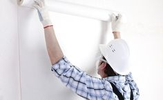 Painter and decorator working in a home