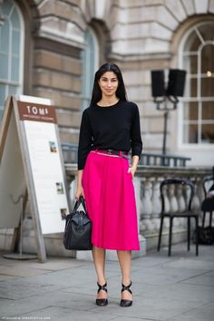 Caroline Issa - love the pop of her vibrant fuschia skirt!