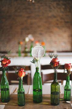 bud vase centerpieces - photo by Morgan Trinker http://ruffledblog.com/irish-themed-wedding-in-nashville #weddingideas #centerpieces #receptions