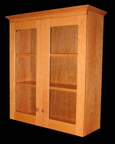 Beautiful Shaker inspired wall cabinet with dovetailed case, glass doors and adjustable shelves handmade in Vermont in solid cherry, maple, oak, walnut or mahogany by Richard Bissell Fine Woodworking. Cove Molding, Veneer Plywood, Mission Furniture, Shaker Cabinets, Fine Woodworking, Adjustable Shelving, Custom Furniture, Glass Door, Bathroom Medicine Cabinet