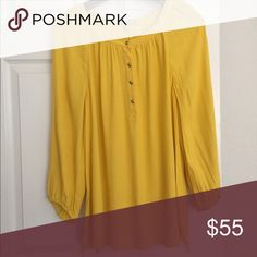 Banana Republic - Yellow Scoop Neck Blouse This top drapes beautifully! Pullover half-placket front with silver buttons at the top and sleeves. Scoop neck. Blousy, 3/4 sleeves. 100% viscose feels like silk crepe. Excellent condition. Worn and dry cleaned. Banana Republic Tops Blouses