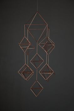 This is the largest piece on my site and will add geometric depth + design + dimention to your space with its unique look. Create a gorgeous cascade of geometry in your home or office. Straw Sculpture, Mobiles, Diamond Decorations, Simple Mobile, Hanging Crystals, Hanging Mobile, Copper And Brass, Handmade Ornaments, Geometric Designs
